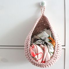 Crochet Storage Hanging basket...looks like it's holding scarves, but wouldn't it be nice for a kids room to put the next days outfit in?!?!