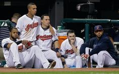 Cleveland Indians Carlos Santana, Michael Brantley, Asdrubal Cabrera, Jason Kipnis and Mike Aviles, from left, watch the Rays celebrate on the Indians' home field.