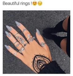 This matte grey on almond nails is perfect. Love rings also