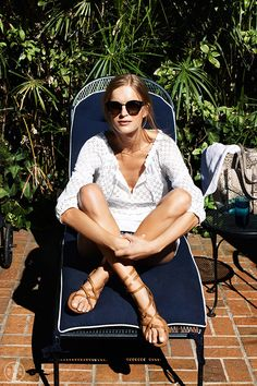 Add poolside polish with tan gladiators: Tory Burch Lucas Flat Sandal.