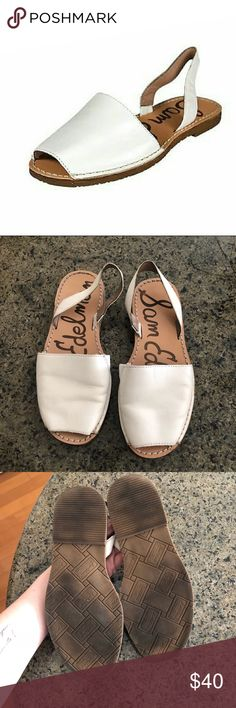 Sam Edelman bray white sling back flats A simple silhouette lends timeless appeal to sturdy Sam Edelman sandals. This pair is crafted in smooth leather and styled with a slingback strap. Rubber sole. Worn a few times.m, no major signs of wear. Some marks on the side of the right shoe. Dirt accumulation on bottom of shoe. Sam Edelman Shoes Flats & Loafers