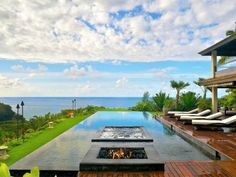 Ocean-side infinity pool with spa and firepit