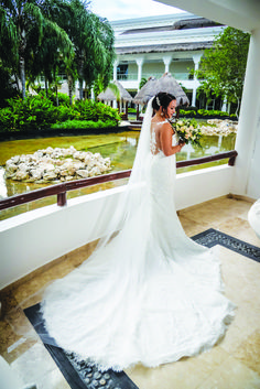 Micaela looked absolutely stunning for her destination wedding at Grand Sunset Princess All Suites and Spa, wearing a lace Rosa Clara gown.  Photographer: Romanza Photography