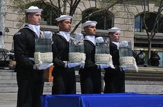 Sailors assigned to the U.S. Navy Ceremonial Guard pour water from the Seven Seas and Great Lakes into the fountains of the outdoor plaza at the Navy Memorial during the Blessing of the Fleet ceremony. (U.S. Navy photo by Mass Communication Specialist 1st Class David A. Frech/Released)
