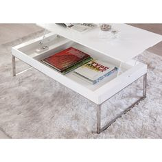 Mesa de centro elevable de líneas sencillas y elegantes con sobre lacado blanco brillo y estructura cromada.