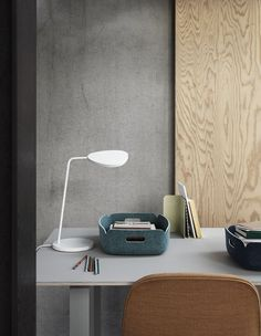Minimal Scandinavian desk light. Inspired by the leaves on a tree, the LEAF lamp series creates an iconic silhouette depending on the positioning of the lamp's shade and viewing angle. LEAF is available in two sizes and uses energy-efficient LED technology. The lamps dim function makes it possible to control both light and mood and it is a stylish addition to any room, whether in the home, office or other commercial setting.
