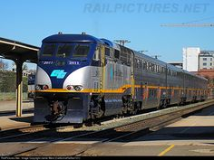 Amtrak California F59PHI #2011 sits idling at the Sacramento Amtrak station after shoving a Capital Corridor train from Oakland Jack London Square. This station has long since been abandoned and a new larger one has been built closer to the old SP Sacramento Shops.
