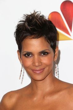 Halle Berry pairs a glittery purple smoky eye with her signature pixie cut.