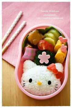 Pink Hello kitty lunch box ideas, happy meal of rice, rolled eggs, tomatoes, broccoli, cucumber, and pork