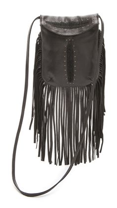 Cleobella Memphis Fringe Bag $271.00 ~ Designed with swinging fringe trim and fishtail accents, this leather Cleobella bag has a western-inspired edge. Antiqued brass hardware punctuates the compact profile, and the magnetic flap opens to a lined interior with a zip pocket. Slim cross-body strap. Dust bag included.  Leather: Goatskin. Weight: 12oz / 0.34kg. Imported, Indonesia.  MEASUREMENTS Height: 9in / 23cm Length: 8in / 20cm Strap drop: 22in / 56cm