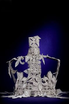 Escada. In honor of the upcoming Queen's Jubilee, the famous London department store Harrod's asked top fashion labels to envision an updated version of the Queen's royal crown.