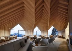 Three blackened-wood huts cantilever from mountain restaurant by Peter Pichler and Pavol Mikolajcak