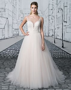 8672cf883c Justin Alexander wedding dresses style 8886 The illusion Sabrina neckline  gives way to a deep V