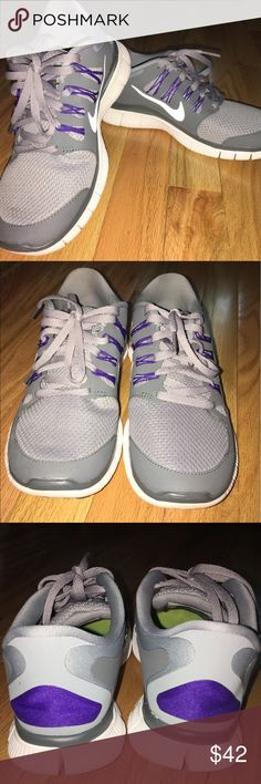Nike Free Run Grey Sneakers Nike Free Run Grey Sneakers w/ purple laces. Size: 7.  Description: Lightweight, breathable mesh upper for a snug fit that moves with the natural motion of the footInjected Phylon midsole for lightweight cushioningLace up closu