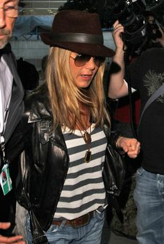 Jennifer Aniston Fedora - Jen traveled in style at LAX in a striped tank paired a brown suede fedora hat.