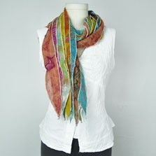 This fabulous recycled sari scarf is a patchwork of luxurious, richly patterned and colored silk. These long, lightweight scarves are each made by hand and completely one-of-a-kind; yours will be its own unique pattern of heavenly colors and prints! $14.00