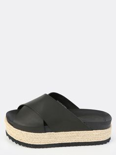 """Modern and chic, the Espadrille Flatform Sandals will give you both height and comfort! Features an open toe, faux leather upper, and a criss cross front design. Finished with a 1.5"""" espadrille/platform heel. Pair with an easygoing t-shirt dress!"""