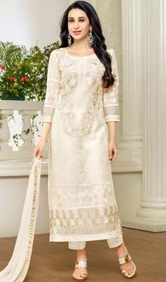 Iconize Karisma Kapoor's style by dressing into this off white color georgette pant suit. This desirable dress is showing some astounding embroidery done with lace and resham work. #dressesonline #eveningwearsalwarkameez #latestfashionsuits