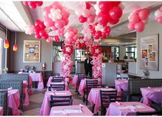 Daddy/Daughter Date Night love the pink carnation flower vases on the table and balloon arch at entrance