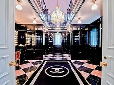 two-story chanel closet with a built in beauty salon...