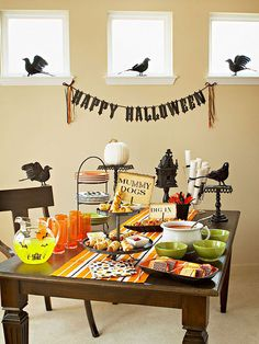 Party guests tend to linger around the food table, so make yours as engaging as possible: http://www.bhg.com/halloween/parties/family-friendly-halloween-party/?socsrc=bhgpin092614startheparty&page=2