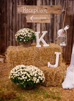 Barn Wedding - Big Wooden Letters & Sign point the way to the reception. Simple yet effective & informational.