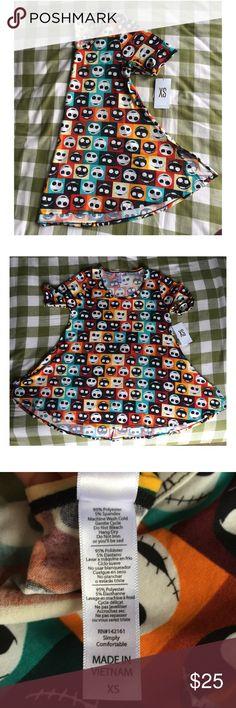 NWT LuLaRoe NBC XS Perfect T NWT LuLaRoe Nightmare Before Christmas XS Perfect T Colorful swing shirt.   Material: 95% Polyester; 5% Spandex LuLaRoe Tops Tees - Short Sleeve