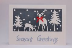 www.etsy.com/shop/SarahLouCards Handmade winter woodland scene acetate Seasons Greetings Christmas card featuring Impression Obsession Fir Trees, Deer & fluffy snowballs
