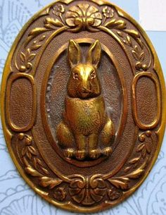 Oval Brass Button with Rabbit Motif.