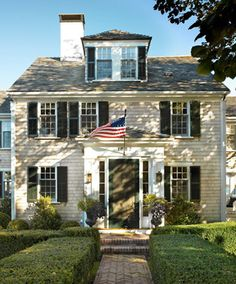 Yes, please. Perfect little 2 story house. American flag is a must.