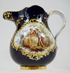 Splendid Antique Meissen Cobalt Scenic Pitcher~The ground color is a deep~rich cobalt blue~There are 2 reserves that are framed with elaborate gilding~On the front is a charming scene of lovers in a garden setting~Made in Germany by Meissen~Circa 1890s