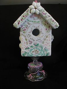 more of my mosaics, painted furniture, tiling, This is a birdhouse for indoor decor only Each side of the roof and all four sides are different but with the same color scheme I used a glass compote for the pedestal and then painted some of the etched part and added jewelry