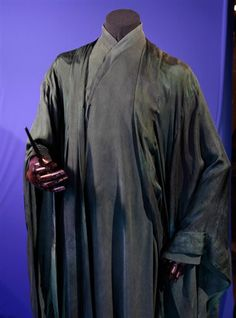 """""""The 'Dark Lord' wore a silk Habotai over-robe in a poisonous green colour to imply allegiance with Slytherin. Beneath this is a heavy, matt, silk crepe-de-chine, cross-over-robe with long, wide, draped sleeves in a slightly lighter green.  Silk was chosen for its draping and dyeing qualities."""""""