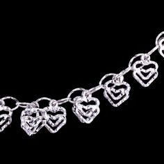 Silver bracelet, hearts. Length: 17-20cm Silver bracelet, Ag 925/1000. Rhodium-plated. Exceptionally romantic bracelet made with fine ovals. On every second loop is attached a double heart with a diamond cut finish creating a glittering effect. Heart dimension is approx. 7x7 mm. Length is adjustable from 17 to 20 cm.
