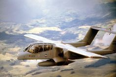 """North American OV-10A Bronco of the 20th Tactical Air Support Squadron (callsign """"Nail"""") in flight over South Vietnam in 1968. Robert F. Dorr Collection"""