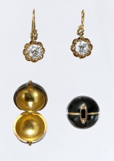 """Pair of earrings with snap-on covers [New York] ca 1882-85. While etiquette proscribed against a show of dazzling stones during the daytime, at night they were worn everywhere. Beauty and practicality combine in these diamond-drop earrings with removable """"coach"""" covers."""