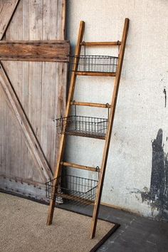 A ladder turned into a storage piece with wire baskets. This would look and function perfectly in almost any room of the house. HomeDecorators.com #storage