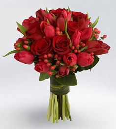 rose and tulip bouquet w/small red berries.....Flowers of Charlotte loves this!   Find us at www.charlotteweddingflorist.com