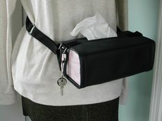 "Style 2 Adjusts to hold tissue boxes 3-4"" deep.Adjustable strap 35"" to 53"", Available with decorative sewn on patches -see Style 4 Comes with D ring and snap ring to carry keys Velcro closures Washable vinyl surface Wrap around arms of wheelchair, Wrap around baby stroller Wrap around car seat Wrap around waist while walking or sitting. $29.99"