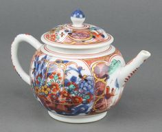 "Lot 162, An 18th Century Chinese Imari pattern bulbous teapot and cover the clobbered decoration with  flowers 4 1/2"" est £80-120"