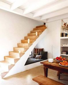 decorating small spaces cubby and pillows under the stairs
