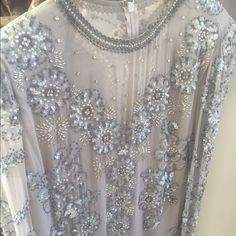 Stunning silk beaded vintage blouse This is sensational – so gorgeous. Size 8 measurements: bust 38 inches, waist 40 inches, length 26 inches. There is one very small superficial spot, that will most likely come out with dry cleaning. Vintage Tops Blouses