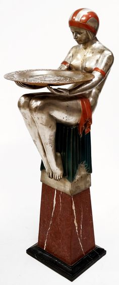 ART DECO BRONZE SILVERED AND POLYCHROMED NUDE FIGURE WITH CHARGER, UPON A MARBLE BASE. HEIGHT 58'