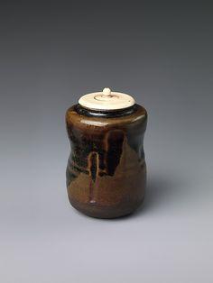 Tea caddy  Period: early Edo period (1615–1868) Date: 17th century Culture: Japan Medium: Stoneware with incision and iron brown glaze (Takatori ware) Dimensions: H. 3 in. (7.6 cm); Diam. 2 1/8 in. (5.4 cm) Classification: Ceramic