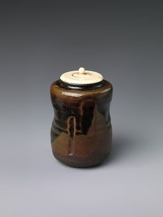 Tea caddy Period: early Edo period (1615–1868) Date: 17th century Culture: Japan Medium: Stoneware with incision and iron brown glaze (Takatori ware) Dimensions: H. 3 in. (7.6 cm); Diam. 2 1/8 in. (5.4 cm) Classification: Ceramic