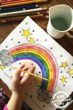 Color this pretty little rainbow coloring page then count, cut and decorate for the day.
