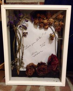 Memorial shadow box: photocopy of handwritten note and dried flowers from the funeral, secured with T-pins
