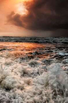 this photo the sunlight helps provide contrast to the foaming waters below. We have this nice orange sunlight coming through the clouds but all around it is surrounded by colder colours and tones. Beautiful World, Beautiful Places, Beautiful Pictures, All Nature, Amazing Nature, Am Meer, Sea And Ocean, Ocean Waves, Ocean Sunset