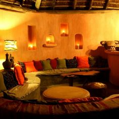Swahilli Style living room. Never thought about this style before but love it! Love the color palette!
