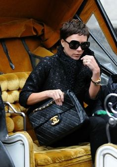 Victoria Beckham looking sultry with a Chanel maxi flap bag